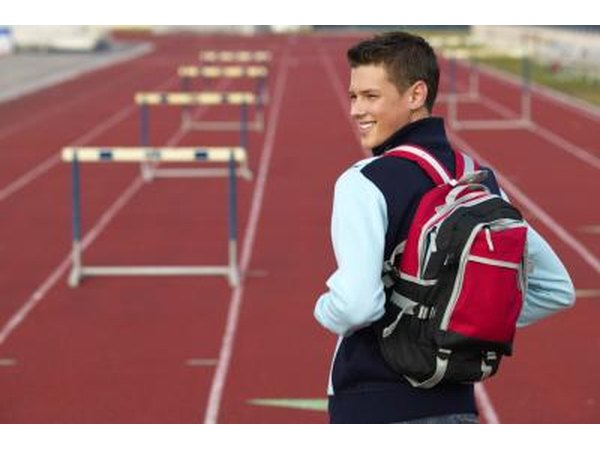 Teenage boy on track with backpack