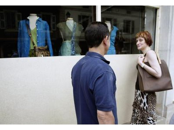 Couple looking at shop window in Geneva, Switzerland