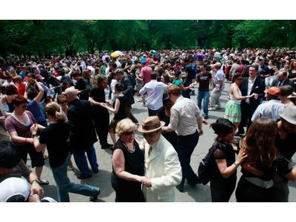 Couples swing dance in honor of legendary Lindy Hop pioneer Frankie Manning