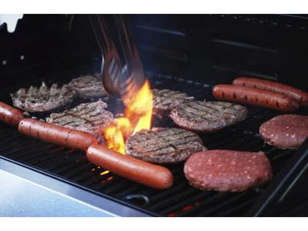hamburgers and hot dogs on the barbecue