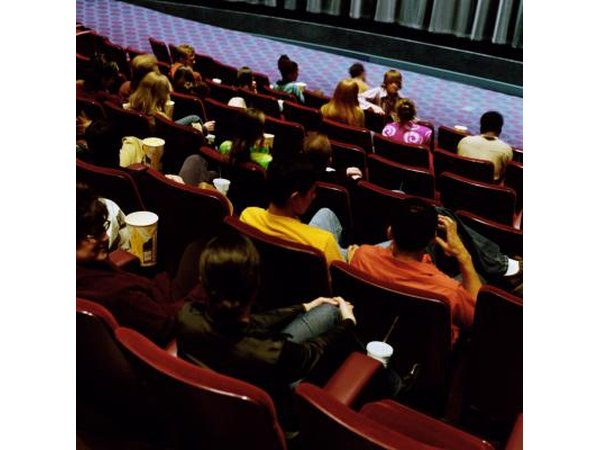 Young people sitting in movie theater