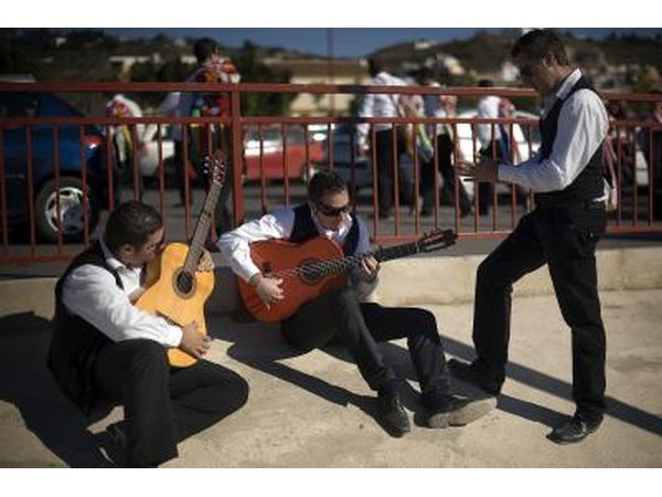 Men playing flamenco guitars in Spain.