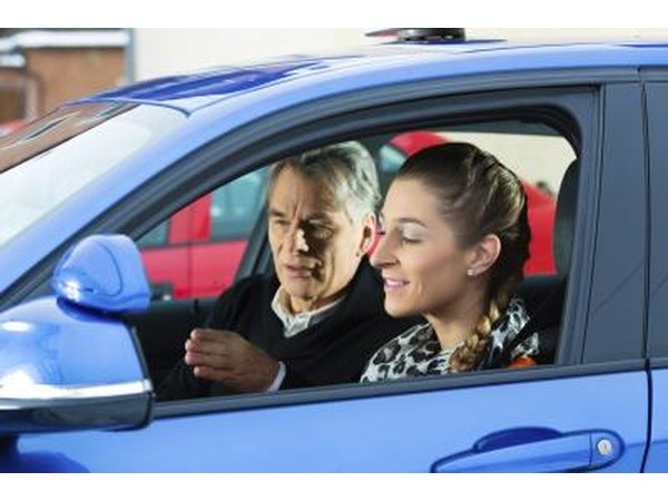 Driving instructor with student