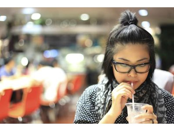 Woman drinking water in food court