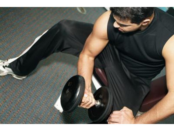 Man exercising with dumbbells in the gym