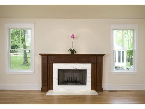 Keep it simple if your fireplace is painted in neutral tones or you just like natural decorative elements