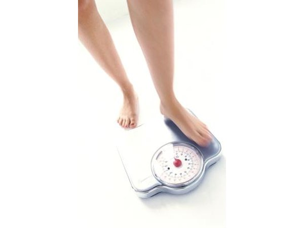 Woman measuring her weight