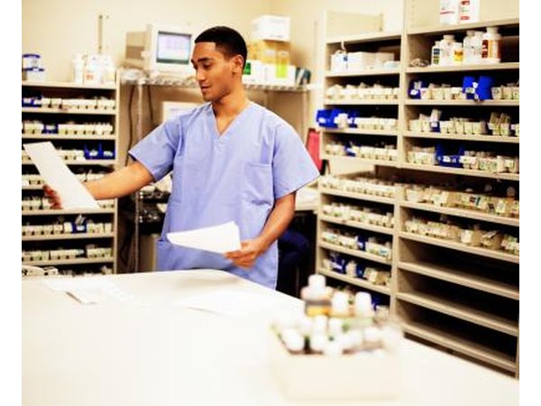 Pharmacist looking at paperwork