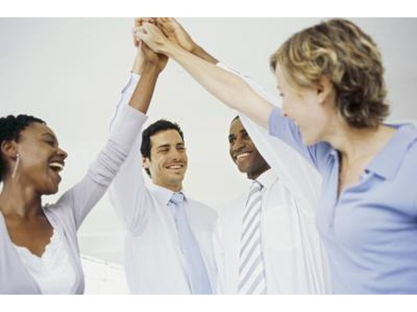 Colleagues doing a group high five