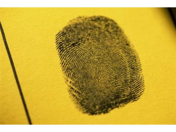 Fingerprint on yellow paper.