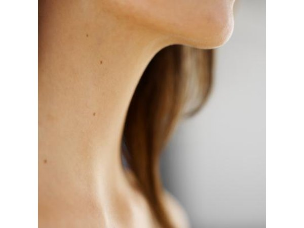 Close-up of woman's neck and throat