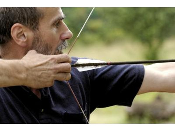 Man aiming bow and arrow