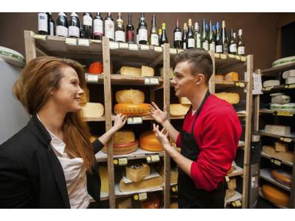 A variety of cheeses and maybe some wines can be found in a specialty cheese shop.
