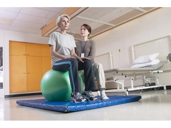 Woman with physical therapist