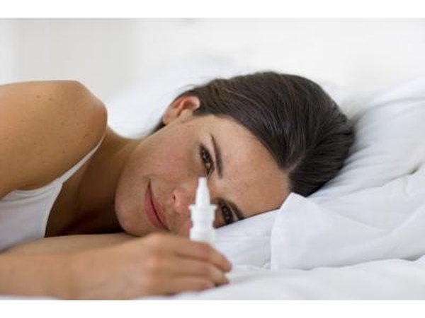 Woman holding nasal spray