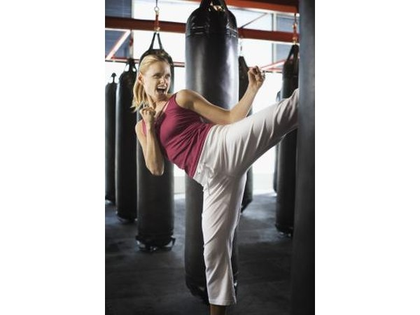 Woman kick boxing
