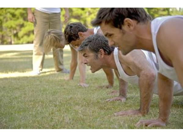 group of people doing pushup's