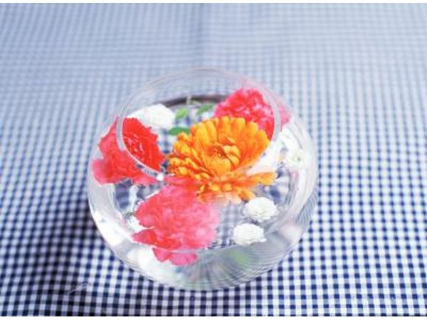 Floating flowers in a bowl is an inexpensive accent to a table.