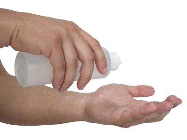 Man putting cream in hands