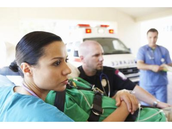 EMTs arrive at an emergency scene and give first aid to those that can't be transported to a hospital unless first treated.