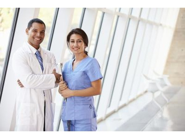 nurse standing beside doctor
