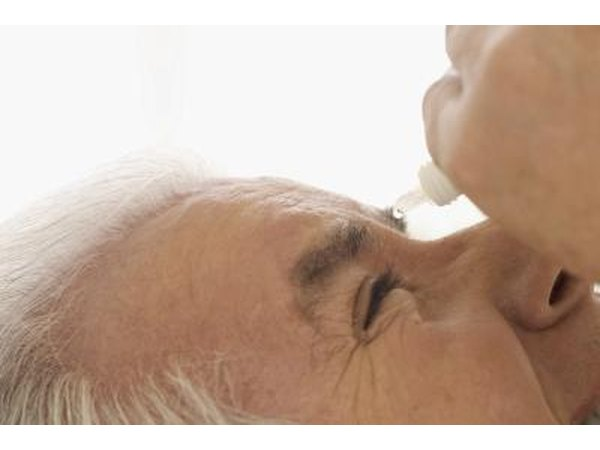 older man using Claritin Eye eye drops