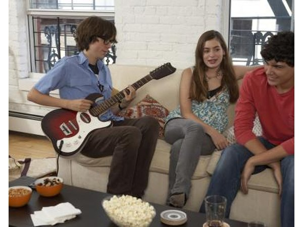 Teens hanging out on couch