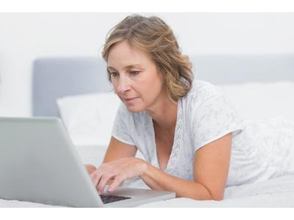 Woman researching about hormone replacement therapy