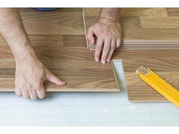 Installing the final pieces of a laminate floor