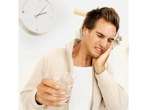 Sharp pain or sensitivity to cold drinks could be caused by receding gums or a cavity