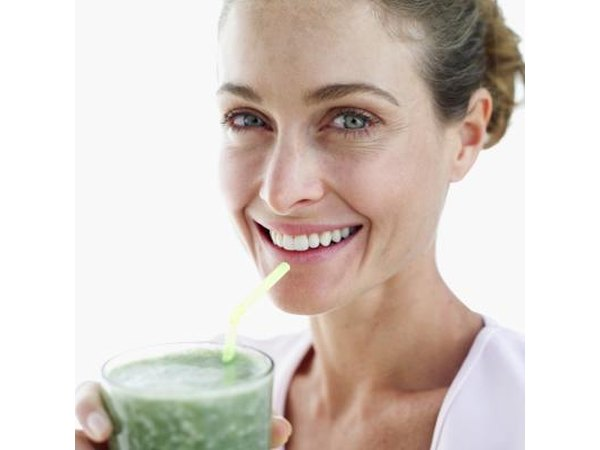 Woman with green juice.
