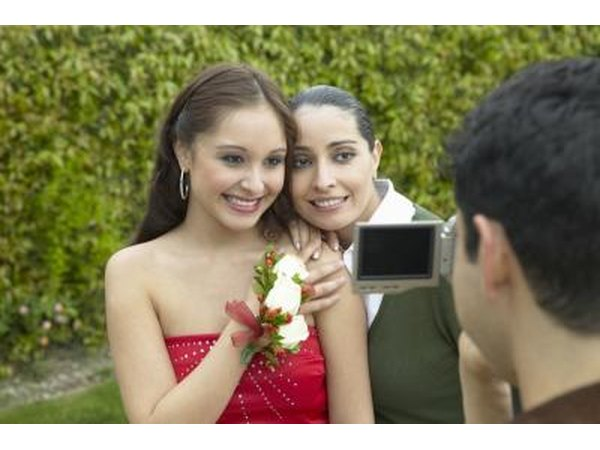 Mother hugging daughter before prom