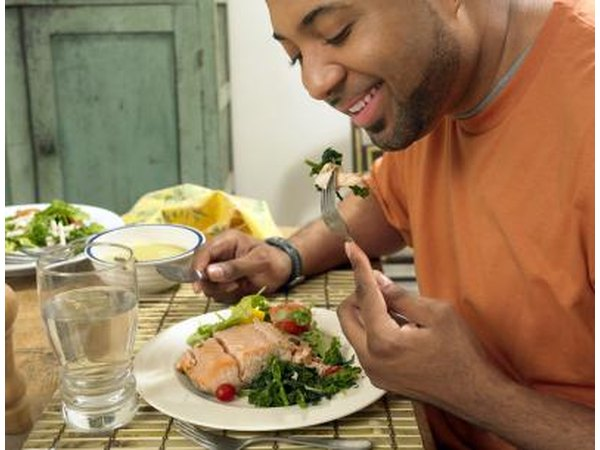 Man eating salmon salad for lunch