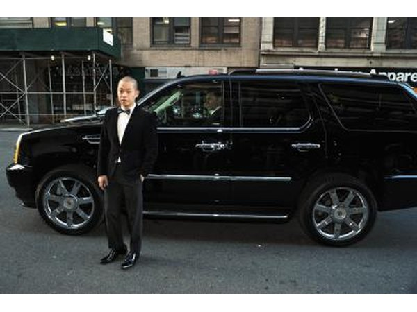A man standing next to an Escalade