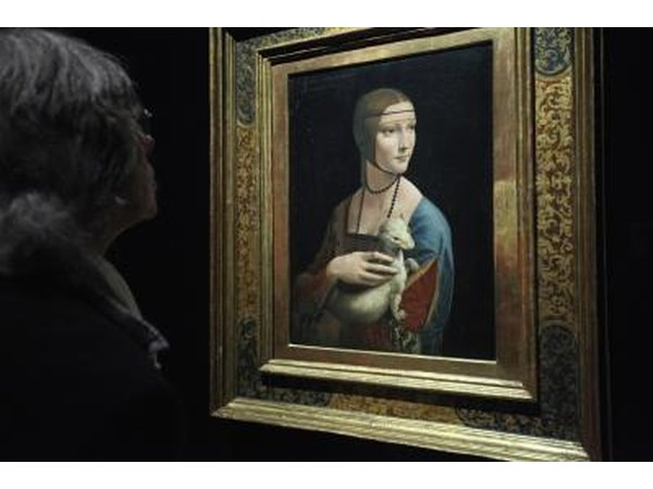"A museum patron looks at the painting ""Lady With An Ermine"", by Renaissance painter Leonardo da Vinci"