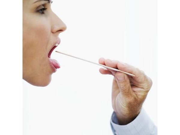 Doctor examining patient's mouth