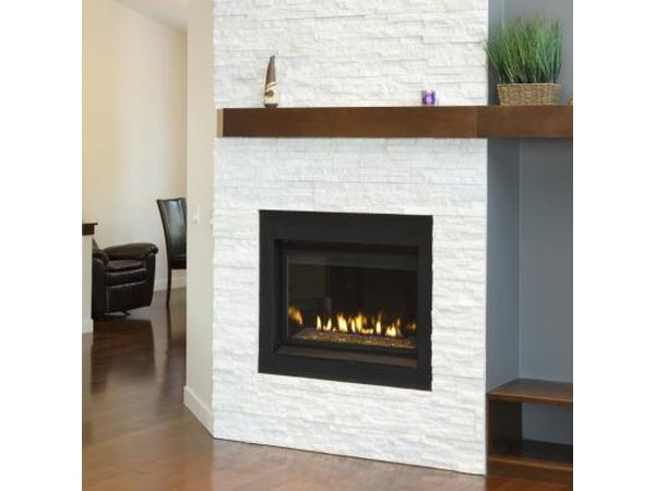 For a modern look, pair white tile with a  dark mantel or a black tile with a white mantel