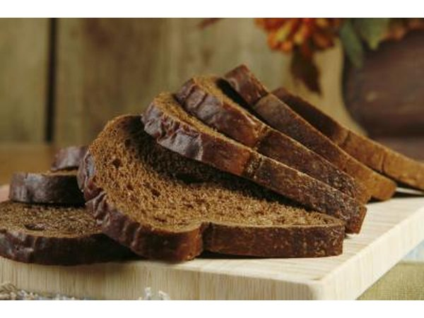 Sliced pumpernickel bread on a cutting board