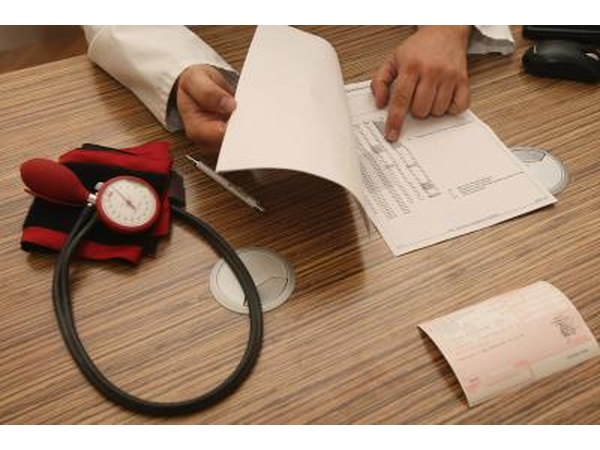 Doctor showing patient high blood pressure / hypertension results