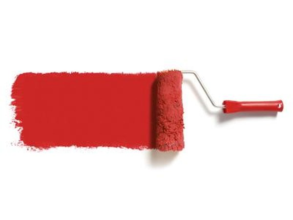 Roller with red paint.