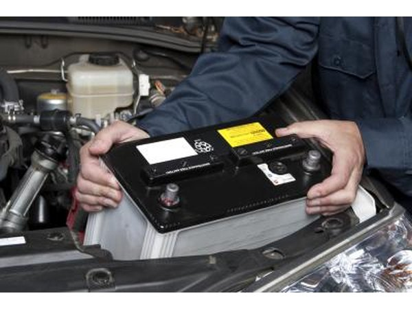 Man removing car battery