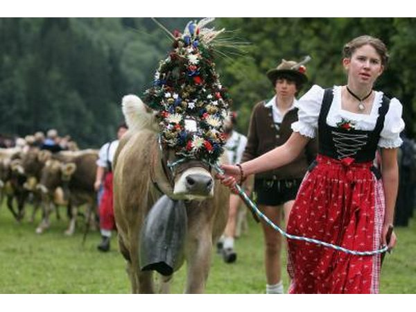 Herdsmen and woman wearing traditional Swiss clothes