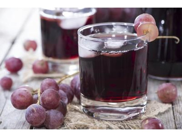 Small glasses of grape juice.