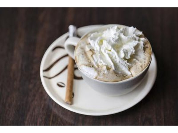 Whipped cream on a cup of coffee.