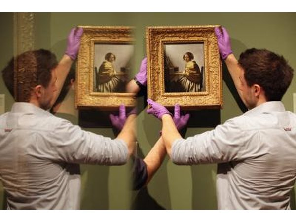 Hanging Vermeer paintings.