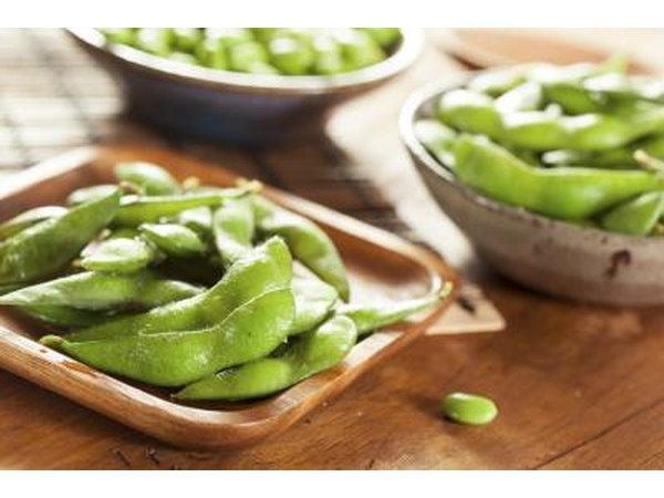 Cooked edamame in small bowls.