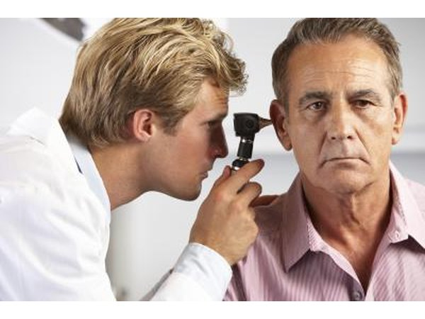 Physician examining patient's ear