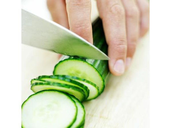 Cucumber being sliced