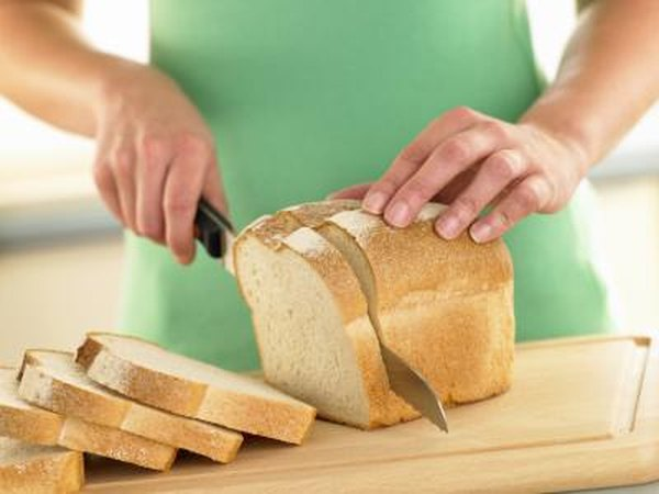woman slicing bread