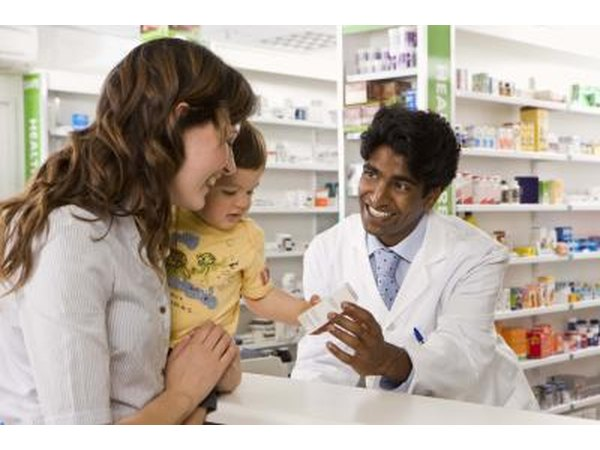 Woman talking to pharmacist